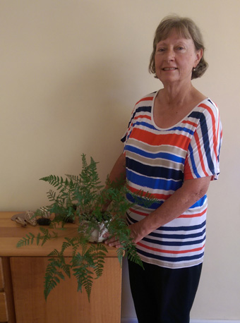 Sue with a fern